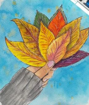 охапка осенних листов в руке